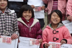 Overjoyed children holding award and certificate